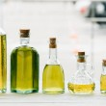 Olive oil bottles on wooden table...