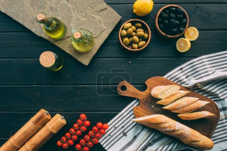 Photo for Flat lay with vegetables and cooking stuff on wooden table with towel - Royalty Free Image