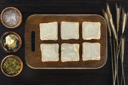 toasts with butter on cutting board