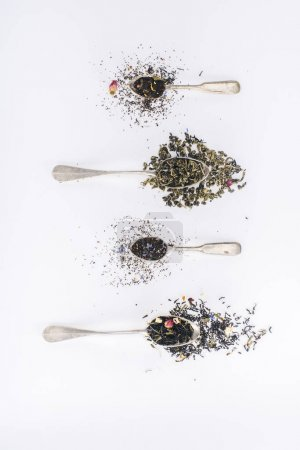 Photo for Top view of healthy aromatic herbal tea and spoons on grey - Royalty Free Image