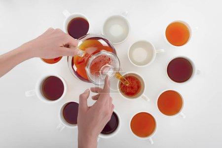 person pouring tea
