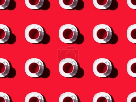 Photo for Top view of tea time seamless pattern with tea cups and saucers on red - Royalty Free Image