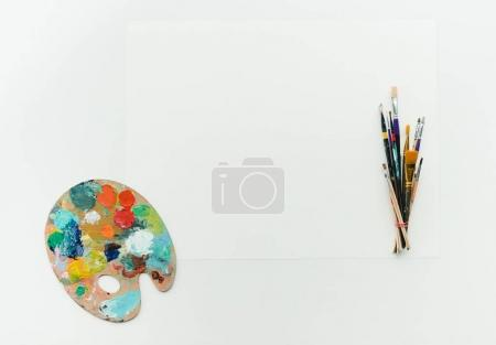 palette with paints and brushes