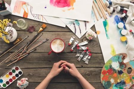 painter sitting at working table