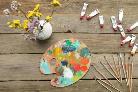 palette with acrylic paints tubes