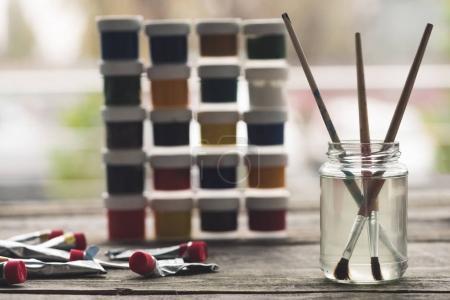 Paint brushes in liquid