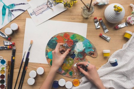 Photo for Cropped image of artist mixing acrylic paints - Royalty Free Image