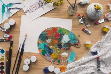 Photo for Top view of palette with oils paints on a table - Royalty Free Image