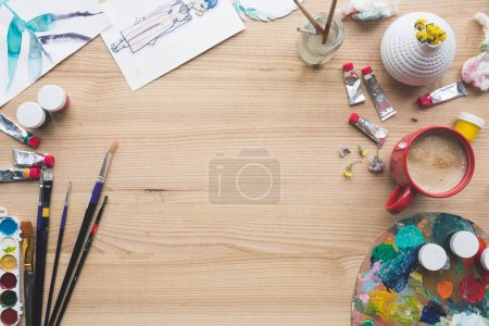 Photo for Top view of painter working place at brown table - Royalty Free Image