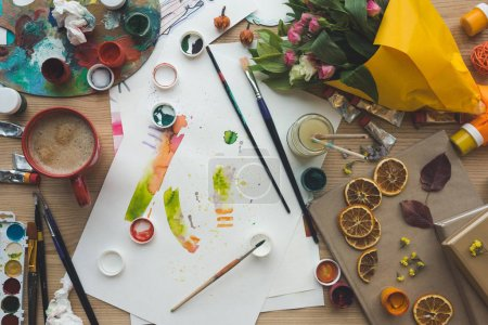 Photo for Top view of painter sketches on a brown table - Royalty Free Image