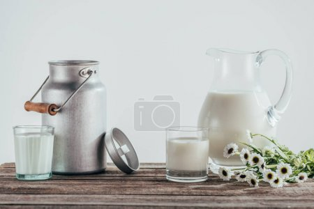 jugs and two glasses of fresh milk