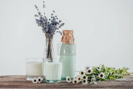 bottle and two glasses of milk with lavender