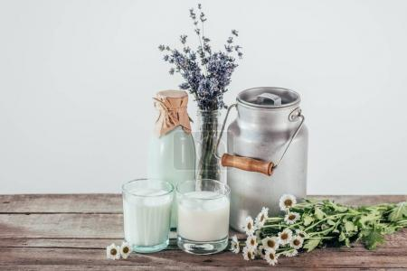 jug, bottle and two glasses of milk