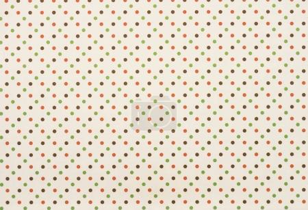 set of seamless colored circles in rows on beige