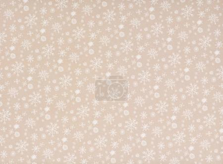 white transparent falling snowflakes on beige
