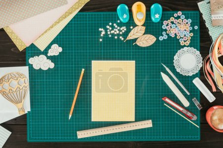Top view of postcard template on a table with decoration for scrapbooking
