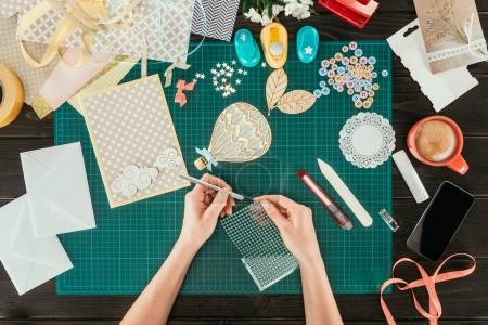 Photo for Cropped image of designer taking sequins for scrapbooking postcard decoration - Royalty Free Image