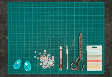 Top view of scale with tools for scrapbooking on gray surface