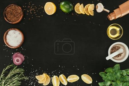 Photo for Top view of various spices and seasonings on black with copy space - Royalty Free Image