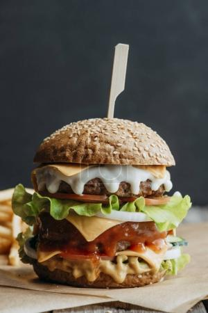 big traditional american homemade cheeseburger on baking paper