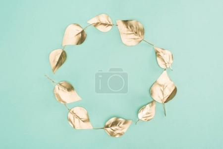 Photo for Top view of golden leaves arranged in circle isolated on blue - Royalty Free Image
