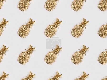 Photo for Full frame of arranged golden pineapples isolated on grey - Royalty Free Image