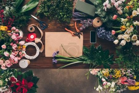 Photo for Top view of sheet of paper and tools for decoration bouquets on table - Royalty Free Image