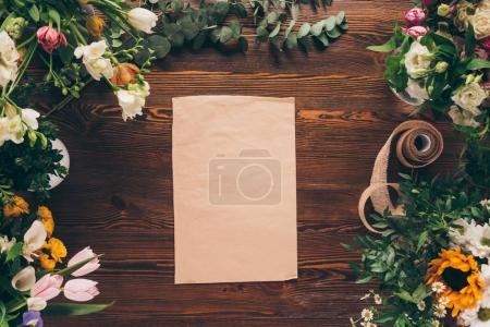 top view of empty sheet of paper on florist table
