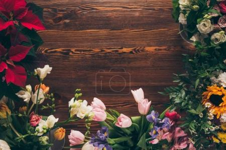 Photo for Top view of colored flowers on table in flower shop - Royalty Free Image