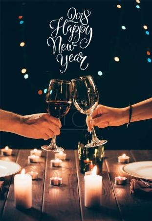 Couple clinking glasses with wine