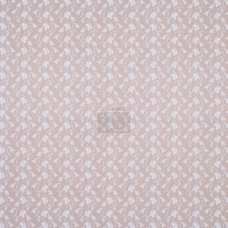 beige wrapper design with white branches
