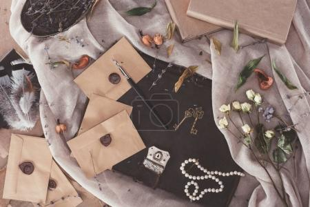 top view of books and envelopes over old fabric