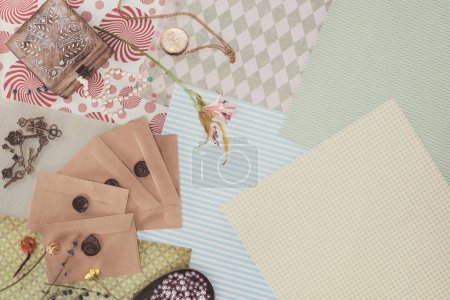 top view of envelopes and jewelry box over pack paper background