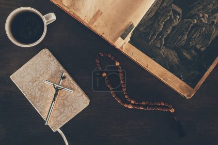 Photo for Top view of open bible and rosary on wooden table - Royalty Free Image