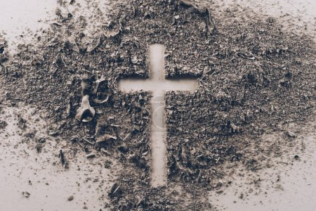 Photo for Top view of cross shape from ash on white table - Royalty Free Image