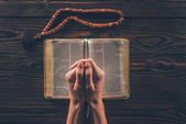 cropped image of christian woman praying with bible
