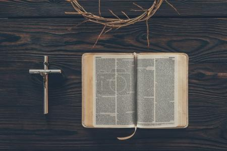 Photo for Top view of crown of thorns with cross and bible on table - Royalty Free Image