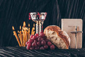 chalice, holy bible, christian cross, candles and food for Holy Communion