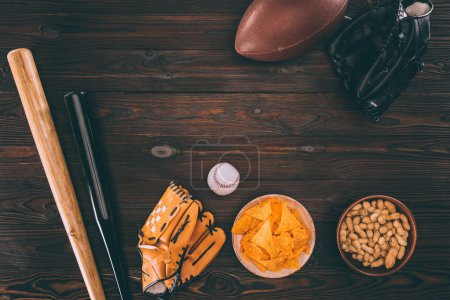 Photo for Top view of various snacks and sports equipment on wooden table - Royalty Free Image
