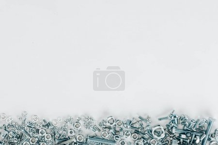 top view of various bolts and framing nails set isolated on white