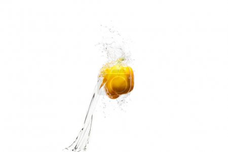 yellow bell pepper in water splashes isolated on white