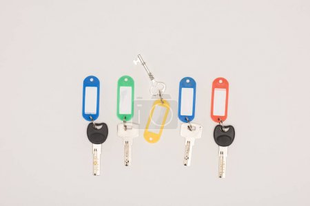 top view set of different keys with colorful labels isolated on white