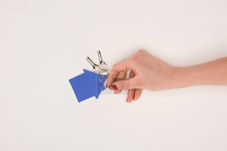 Photo for Cropped image of female hand holding key from house isolated on white - Royalty Free Image