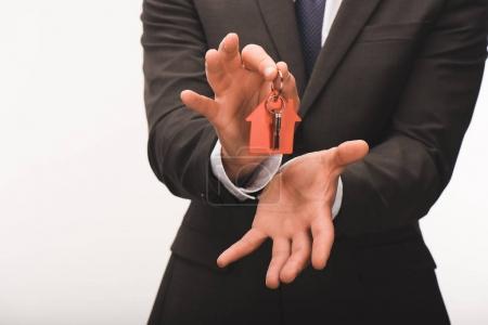 Photo pour Image recadrée de l'homme touche de maison isolé sur blanc - image libre de droit