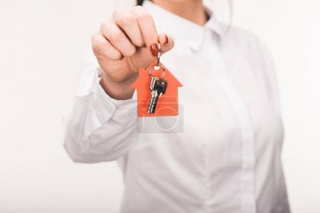 Photo for Cropped image of female holding key from house isolated on white - Royalty Free Image