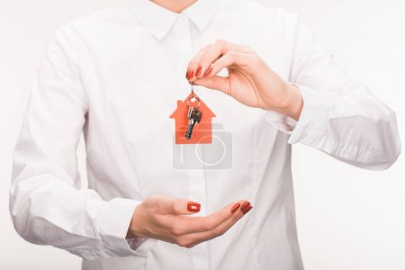 Photo pour Image recadrée de femelle enfoncée de maison isolé sur blanc - image libre de droit