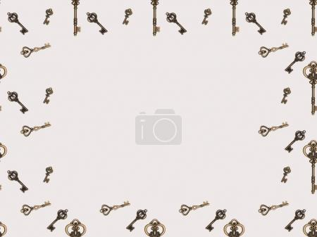 top view of different metal keys frame isolated on white