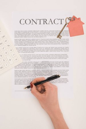 top view of cropped hand signs contract of buying house isolated on white