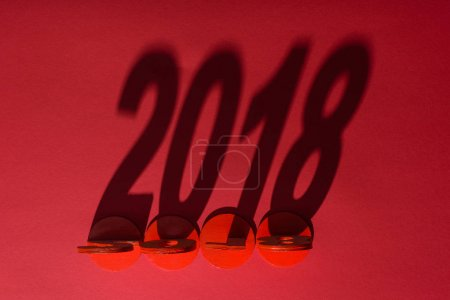 top view of 2018 year sign shadow isolated on red