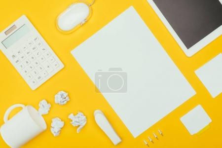 Photo for Top view of blank sheet of paper, crumpled papers, notes, calculator and cup isolated on yellow - Royalty Free Image